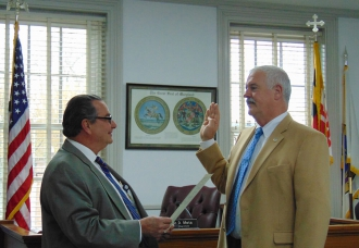 Jim Beauchamp takes oath for his second term as Town Council member.